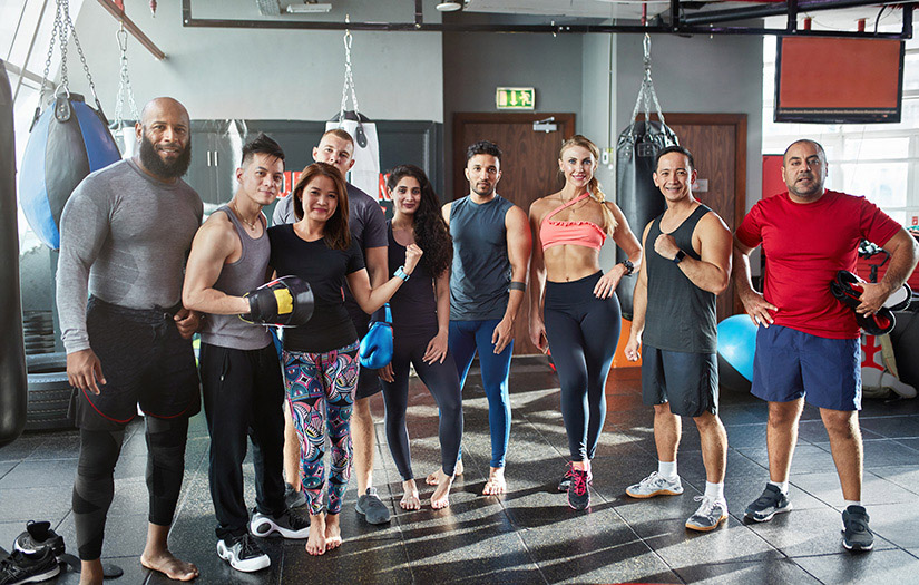 a class of group fitness participants posing