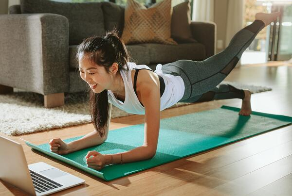 woman-watching-sports-training-online-on-laptop-picture-id1098382614-1